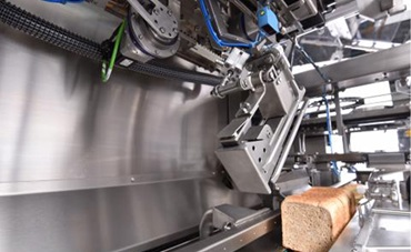 Bread wrapping machine